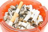 stock photo of butts  - butts in red ashtray on white background - JPG