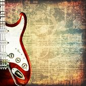 image of music symbol  - abstract grunge cracked music symbols vintage background with electric guitar - JPG