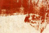 stock photo of scratch  - Vintage old damaged wall with cracks scratches painted with red paint - JPG
