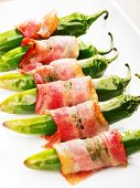 image of jalapeno  - Grilled jalapenos wrapped in bacon isolated on white - JPG