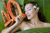 stock photo of papaya  - Beautiful caucasian woman having fresh papaya natural facial mask apply skin care and wellness - JPG