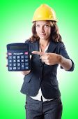 image of overspending  - Female builder with calculator on white - JPG