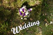stock photo of gladiolus  - Colorful wedding bouquet with roses and gladiolus on the grass - JPG