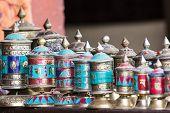 stock photo of sanskrit  - Traditional tibetan praying wheels in Katmandu - JPG