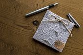 foto of scribes  - Old diary memories with a pen on a wooden table - JPG