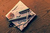 foto of scribes  - Old diary memories with fountain pen on a wooden table - JPG