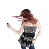picture of jive  - Young Woman With Tousled Hair Wearing Trendy Outfit Listening to Music from MP3 - JPG