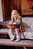 picture of country girl  - happy blonde child girl playing with easter decorations at country house in spring - JPG
