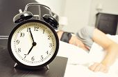 stock photo of blindfolded man  - closeup of an alarm clock at 6 - JPG