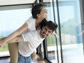 stock photo of romantic  - romantic happy young couple relax at modern home indoors and have fun - JPG