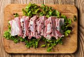 picture of charcuterie  - Raw pork ribs on a cutting board - JPG