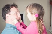 pic of love making  - little girl being playing and making faces with her dad - JPG