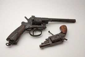 image of revolver  - old revolver style derringer and colt rusty and damage - JPG