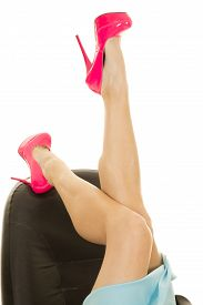 pic of up-skirt  - a woman in her skirt kicking her feet up on her office chair - JPG