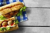 picture of meatball  - Homemade Spicy Meatball Sub Sandwich on wooden table background - JPG