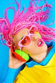 stock photo of dreadlock  - Ultra trendy DJ party girl in bright clothes - JPG