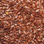 picture of flax seed oil  - The flax seeds as a background close up - JPG