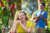 pic of enthusiastic  - Beautiful enthusiastic senior woman and ukulele player on vacation - JPG