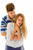 picture of choke  - Couple demonstrating first aid techniques by man performing heimlich on female choking - JPG