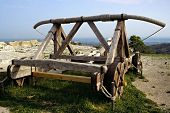 stock photo of trebuchet  - old medieval war machine outside a french castle - JPG