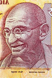 picture of gandhi  - Closeup of Mahatma Gandhi on 10 Rupees Indian currency note - JPG
