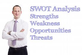 stock photo of swot analysis  - SWOT Analysis Young businessman with blue text isolated on white background - JPG