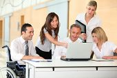 foto of business meetings  - Group of office workers in a business meeting - JPG