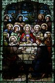 stock photo of stained glass  - Jesus is surrounded by his disciples in this beautiful stained glass scene of the last supper - JPG