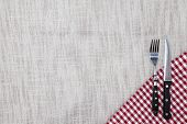 The background to create the restaurants menu. Linen tablecloth fork knife on a bright checkered cl poster