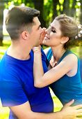 Couple together walk in park. In love guy and girl hold hands. Man and woman walking outdoor. Love o poster