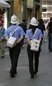 Two Italian Police officers, one man, one woman, walk through the streets of Florence, Italy