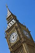 Close up of the clock face on the famous landmark clock tower known as Big Ben in London, England. Part of the Palace of Westminster also known as the Houses of Parliament. poster