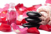zen stones, essential oil and rose petals isolated