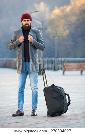 poster of Man Bearded Hipster Travel With Big Luggage Bag Wait For Taxi Bring Him To Hotel. Travel Tips. Trave