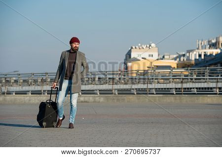 poster of Business Trip. Man Bearded Hipster Travel With Big Luggage Bag On Wheels. Let Travel Begin. Traveler