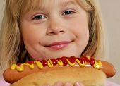 image of hot dog  - Little girl eating a hot dog - JPG