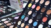 Stand With Bright Colored Tester Eye Shadow Samples In Beauty Store. Makeup Shop, Mineral Shadow, Ey poster