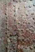 Rusty Metal Texture. Studded Iron Plate. Rivets On Old Rusty Metal Door. Weathered Aged Grunge Textu poster