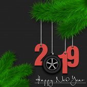 Happy New Year And Numbers 2019 And Car Wheel As A Christmas Decorations Hanging On A Christmas Tree poster
