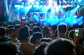 Concert Crowd Of Music Fanclub Hand Holding Mobile Smart Phone Taking Video Record Or Live Stream Wi poster