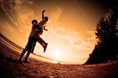 stock photo of boy girl shadow  - happiness and  romantic Scene of love couples on the Beach - JPG