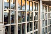 Panoramic Wooden Windows Showcase A Cafe Shop In Retro Style, The Window Frame Made Of Wood Is A Clo poster