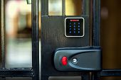 A Security Lock On An Iron Gate With A Touch Panel For Access By An Access Code Key Or A Classic Key poster