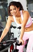 picture of gym workout  - girl working out at the gym looking happy - JPG