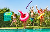 Joyful Kids Having Fun During Summer Pool Party poster