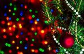 Red Christmas Ball On Christmas Tree With Blurred Lights. Christmas Ball And Lights On Dark Blur Bac poster