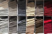 Multicolor Socks Stacked On Shelf In Tidy Appearance In A Clothing Store. Multicolor Sock Background poster