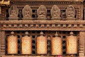 tibetan prayer wheels at monkey temple, Kathmandu, Nepal