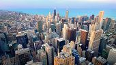 Aerial View Of Downtown Chicago City Skyline And Lake Michigan From Above In Chicago, Illinois poster