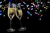 Two Champagne Glasses Toast Against A Dark Background With Colorful Bokeh Lights, New Year And Party poster